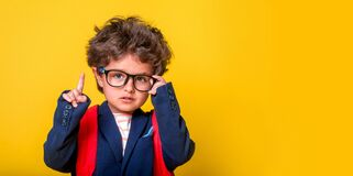 Free Surprised Smart Kid Boy In Big Glasses Isolated On Yellow Background. Education. Kindergarten Little Child With Backpack Stock Images - 217385784