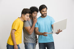 Surprised Smart male friends with laptop computer Royalty Free Stock Photo