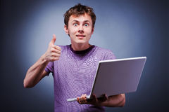 Surprised smile thumb up man with laptop. Surprised man in shirt with laptop thumb up Royalty Free Stock Photo