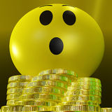 Surprised Smiley With Coins Showing Sudden Success Stock Photography