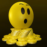 Surprised Smiley With Coins Shows Unexpected Earnings Royalty Free Stock Image