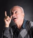 Surprised smiling elderly man Stock Image