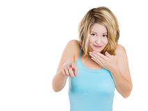 surprised, smiling, giggling young woman pointing with her finger at you Royalty Free Stock Photography