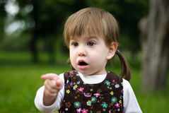 Surprised smiling little girl Stock Photos