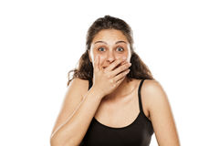 Surprised and smiling. Woman covering her mouth with her hand Royalty Free Stock Photo