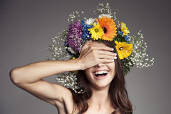 Surprised Smiling Woman With Flower Wreath On Her Head. Stock Photo