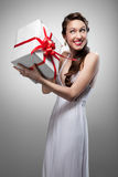 Surprised smiling woman holding gift Stock Photos
