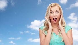 Surprised smiling young woman or teenage girl Stock Photo
