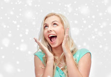 Surprised smiling young woman or teenage girl Stock Photography