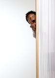 Surprised Snoop. Hiding behind a screen Stock Photography