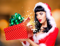 Surprised  snow maiden looks into the christmas box  with gift i Royalty Free Stock Photo