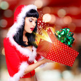 Surprised  snow maiden looks into the christmas box  with gift i Royalty Free Stock Image