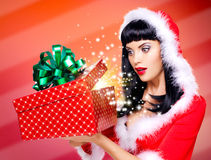 Surprised  snow maiden looks into the christmas box  with gift i Royalty Free Stock Photography