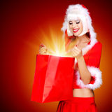 Surprised snow maiden with shopping bags with magic light Royalty Free Stock Photography
