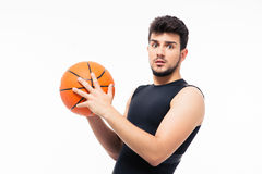 Surprised sports man holding basketball Stock Photography
