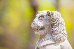 Surprised stone lion figure Royalty Free Stock Photo