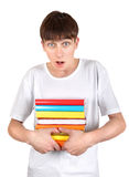 Surprised Student with a Books. Surprised Student Holding Pile of the Books Isolated on the White Background Stock Photo