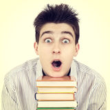 Surprised Student with the Books Stock Photos
