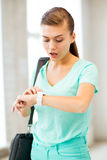 Surprised student girl looking at clock Stock Photography