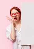 Surprised student girl in white shirt and glasses Royalty Free Stock Images