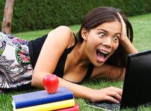 Surprised student on laptop Royalty Free Stock Images