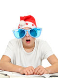 Surprised Student in Santa Hat Stock Photo