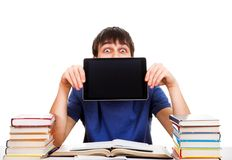 Student with a Tablet. Surprised Student show the Tablet Computer on the School Desk Royalty Free Stock Photography