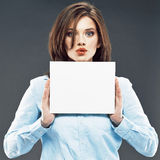 Surprised student show white card. Royalty Free Stock Image