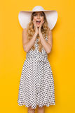 Surprised Summer Woman In White Sun Hat Is Holding Head In Hands Royalty Free Stock Images