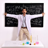Surprised teacher at the blackboard Royalty Free Stock Photos
