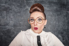 Surprised teacher with eyeglasses Royalty Free Stock Photo