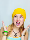 Surprised teen with easter candies on lips.  Royalty Free Stock Photos