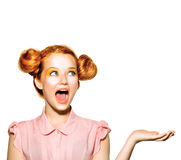 Surprised teen girl with freckles. Red hairstyle, yellow makeup Stock Photos