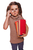 Surprised teen girl frightened, confused child with books school Stock Images