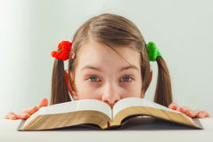 Surprised teen girl with the Bible Royalty Free Stock Photography