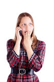 Surprised teen girl talking on the mobile phone Royalty Free Stock Photography