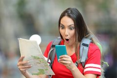 Surprised teen tourist reading online content Stock Photography