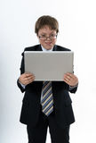 Surprised teenage boy with laptop. Surprised teenage boy with white laptop in his hands Royalty Free Stock Images