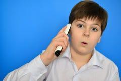 Surprised teenage boy talking by radiotelephony Stock Photos