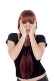 Surprised teenage girl dressed in black with a piercing Royalty Free Stock Photo