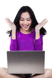 Surprised teenage girl with lapotp in studio Royalty Free Stock Photography