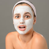 Surprised teenage girl looking camera face mask Stock Images