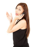 Surprised teenage girl on the phone Stock Image