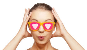 Surprised teenage girl in pink sunglasses Royalty Free Stock Images