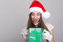Surprised teenage girl receiving Christmas gift Royalty Free Stock Image