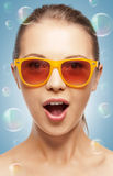 Surprised teenage girl in shades Royalty Free Stock Images