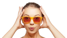 Surprised teenage girl in sunglasses Royalty Free Stock Photography