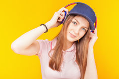 Surprised teenage girl uses a headphones Stock Photos
