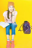 Surprised teenage girl uses a mobile phone Royalty Free Stock Photos