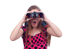 Surprised teenage girl watching with binoculars Royalty Free Stock Image